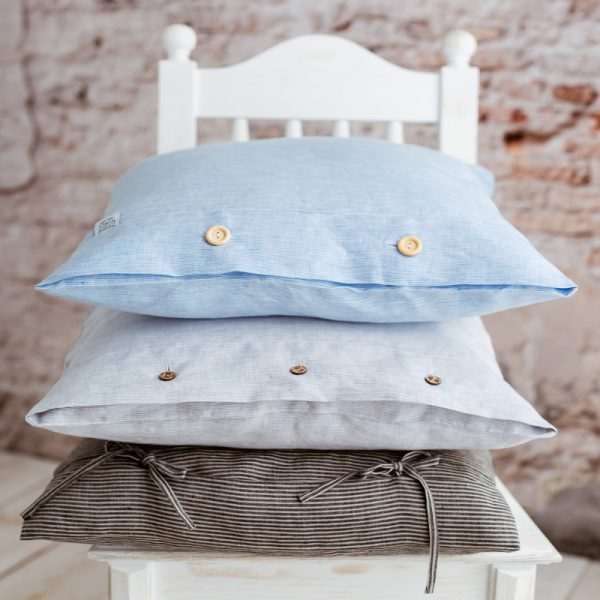 bows on pillowcase white blue